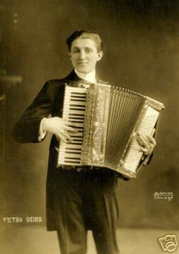 Swave guy in tux and tails, with fancy vaudeville accordion.