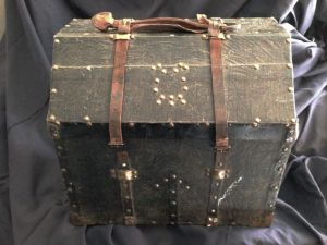 Old accordion case, with worn leather straps.