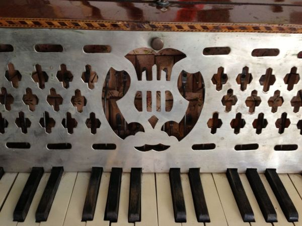 Antique Piano Accordion - a little crooked, but at its age, cut it some slack.