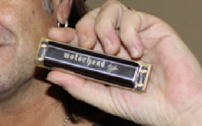 Custom Motörhead Hohner Harmonica.  That is Phil Campbell's ear there.