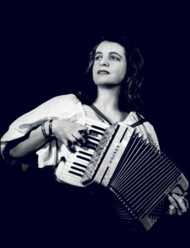 Jenny Vincent as a young women playing her accordion