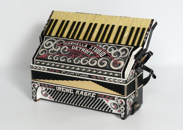 "Flowtone Accordion, 1920's era? covered in rein-stone swirling decorations. Unbelievable. Name-plate, ""Irene Kaske."""