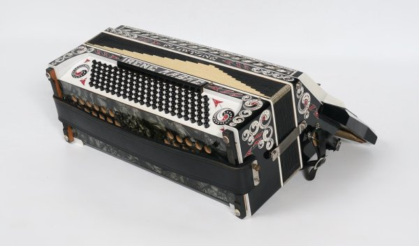 Flowtone Accordion, 1920's era? covered in rein-stone swirling decorations. Like water or clouds or yin-yang icons. Amazing