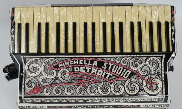 "Grill detail: Flowtone Accordion, 1920's era? covered in rein-stone swirling decorations. Unbelievable. ""Minchella Studio Detroit."""