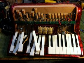 Busted up Accordion Keyboard