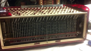Accordion Bass machinery with buttons stuck inside