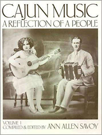 Book cover, with photo of well dressed couple, Cleoma Breaux with guitar and Joe Falcon on button accordion