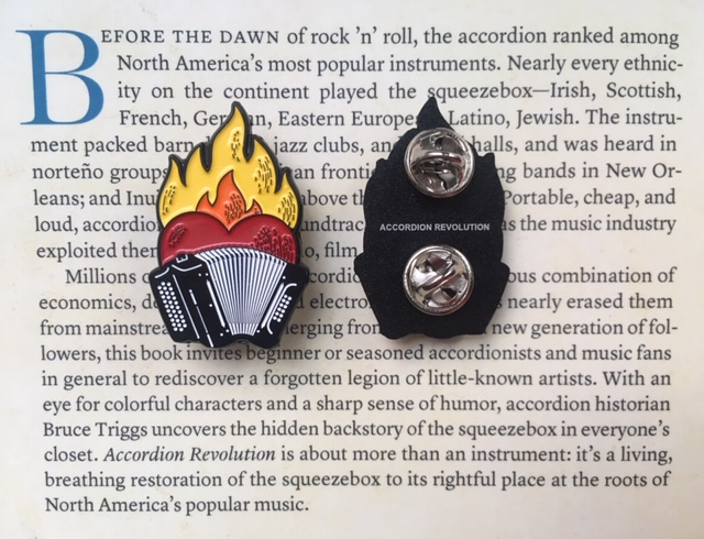 Two Flaming-heart accordion pins, front and back, Back is black with tiny 'Accordion Revolution' and twin silver badge-backing. Background of image is the 'about the book' paragraphs from the back of the Accordion Revolution book.