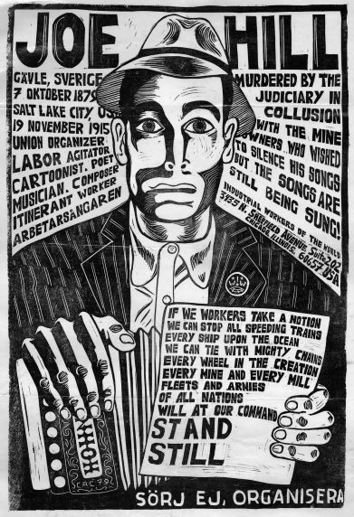 """Woodcut of Joe Hill, with his little Hohner accordion and the story of his murder by the state of Utah in  1915. """"If we workers take a notion we can stop all speeding trains, every ship upon the ocean. We can tie with mighty chains every wheel in creation, every mine and every mill. Fleets and  Armies of all nations will at our command stand still."""""""