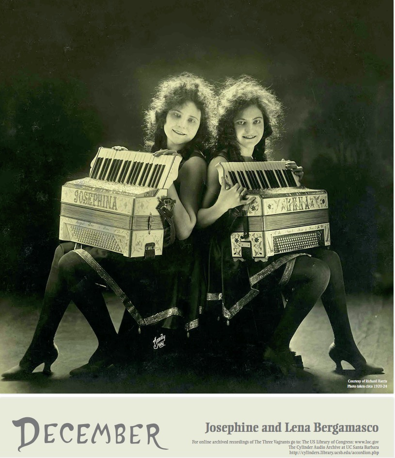 Antique photo of two women in fancy vaudeville show dresses and hairdos. Their fancy 1920s accordions are labeled